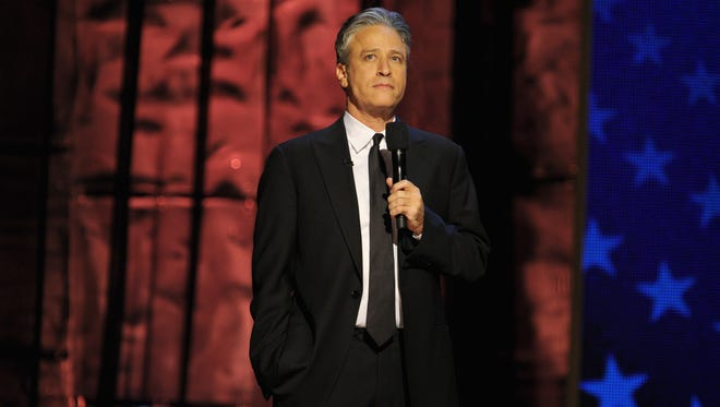 Jon Stewart speaks onstage at Comedy Central's night of too many stars: America comes together for autism programs at The Beacon Theatre on Oct.13, 2012, in New York City.
