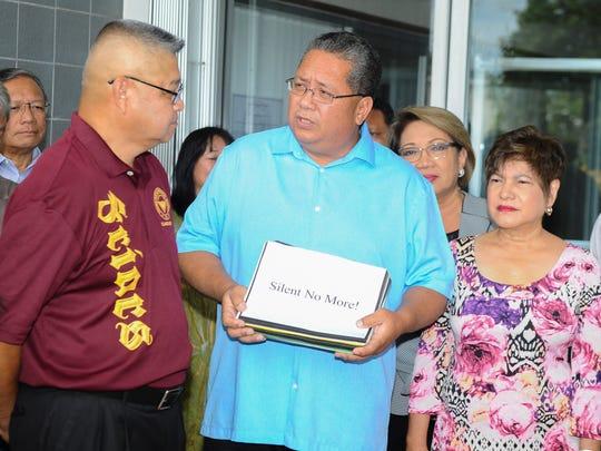 In this Sept. 8 file photo, Sen. Frank Blas Jr., center,