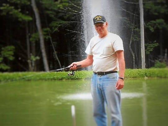 Walter Paul Morris, 66, was an avid fishermen. He is shown fishing in 2015.