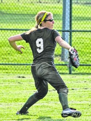 Ursuline's Hannah Mehrle throws a ball in from center field during the Lions' 5-1 win over Seton at the Blue Ash Sports Complex April 18, 2012.