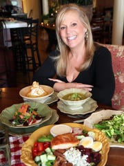 Owner Leslie Lampert with food prepared at the Cafe