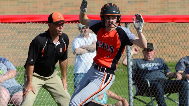 Gibsonburg's Keely Snyder rounds third with a triple Tuesday.