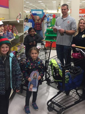 Dontesha, Zoe and the Weisner family during Two Rivers Police Department's Shop with a Cop event.