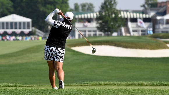 Shanshan Feng tees off at hole 18 during Round 1 of