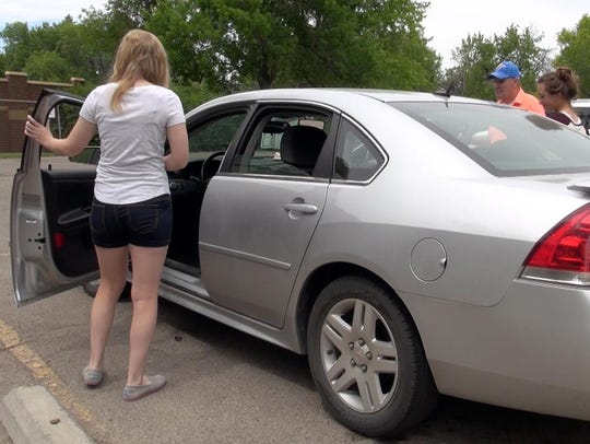 Driver's education student Eden Martin enters the vehicle