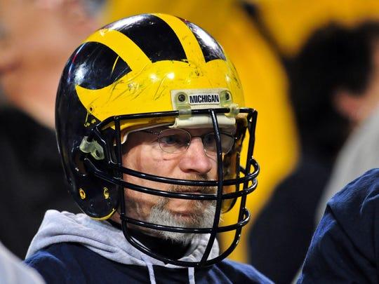 A Michigan fan at the Buffalo Wild Wings Bowl in 2013.