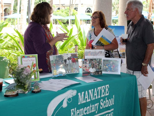 Mike and Sue Horowitz with Manatee Elementary representative (left)