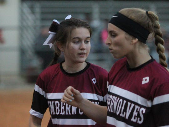 Chiles' Dani Bauer (left) cheers on fellow pitcher Allie Lavoie.