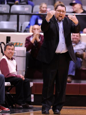 McMurry head coach Clif Carroll yells to his team during the first half of the War Hawks' 77-60 loss on Saturday, Jan. 18, 2014, at Kimbrell Arena.