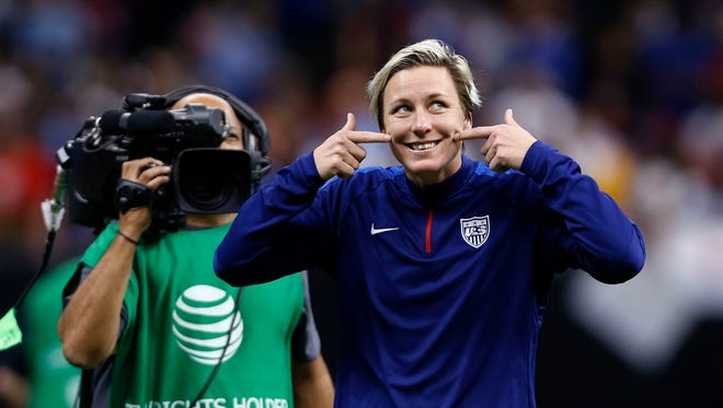 U.S. forward Abby Wambach shows a smile to the crowd after the team's international friendly soccer match Wednesday against China in New Orleans. The U.S. lost 1-0.