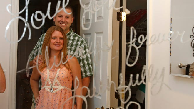 A mirror with a handwritten love note reflects Lisa and Jason Rooms and their perpetual gestures of romance. They've been married for years and have three young daughters, but they still write each other notes all the time.