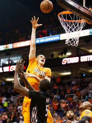 Phoenix Suns Alex Len puts up a hook shot against the Minnesota Timberwolves during NBA action on Jan. 16, 2015, in Phoenix.