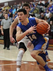 Clyde's Zach Rieman drives to the basket Saturday against Genoa.