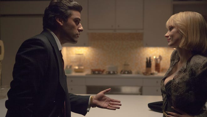 "Oscar Isaac and Jessica Chastain in ""A Most Violent Year."""