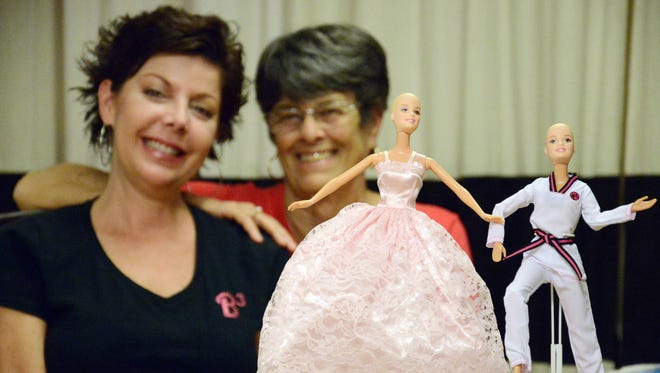 Wanda Schultz, right, and Valerie Paul, left, collect Barbie dolls, make them bald and then donate them to children with cancer.