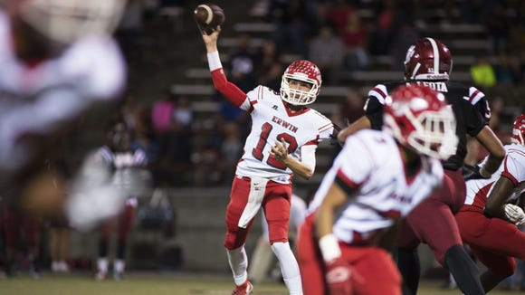 Erwin's Damien Ferguson throws a pass in Friday's win