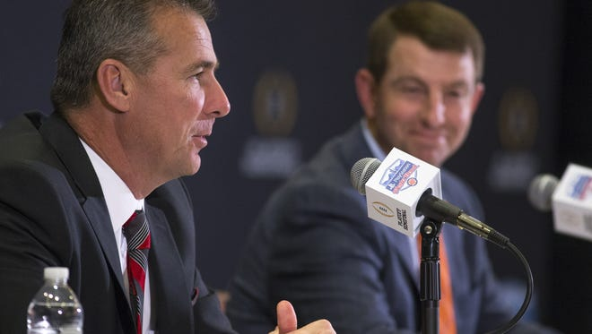 Ohio State's coach Urban Meyer, left, and Clemson's coach Dabo Swinney answer questions during a Fiesta Bowl press conference.