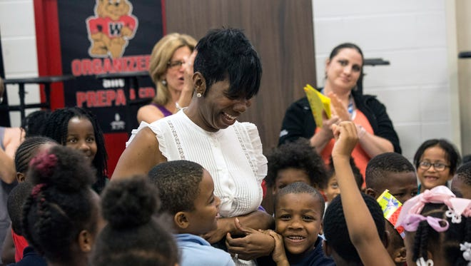 Wheatley Elementary teacher NyRee D. Clayton-Taylor is surrounded by the love of her students while being celebrated for winning the Elementary Teacher of the Year on Thursday afternoon. 5/17/18