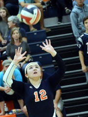 Beech High junior Reeves Parrish sets a ball during the opening game.