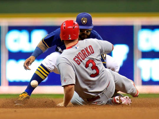 St. Louis Cardinals' Jedd Gyorko, front, is safe at second base as Milwaukee Brewers second baseman Jonathan Villar, back, can not catch the ball during the fourth inning of a baseball game Thursday, April 20, 2017, in Milwaukee. (AP Photo/Darren Hauck)
