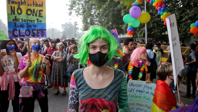 A participant wears a pollution mask as gay rights activists and their supporters march during a gay pride parade in New Delhi, India, Sunday, Nov. 12, 2017.