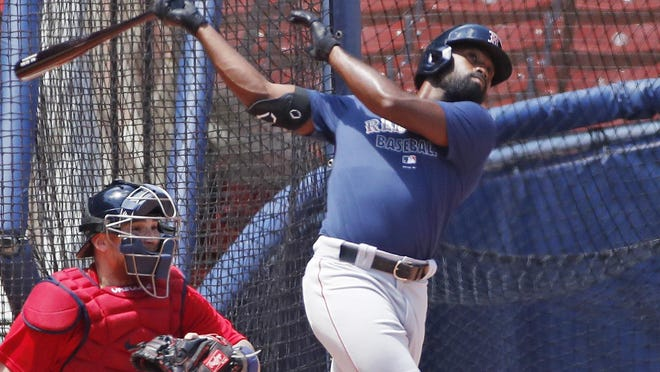 Red Sox outfielder Jackie Bradley Jr. takes batting practice with Christian Vázquez catching during training camp at Fenway Park on Monday.