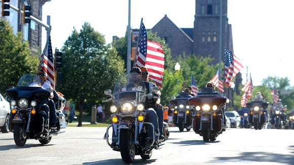 Motorcyclists take part in the Hot Harley Nights parade