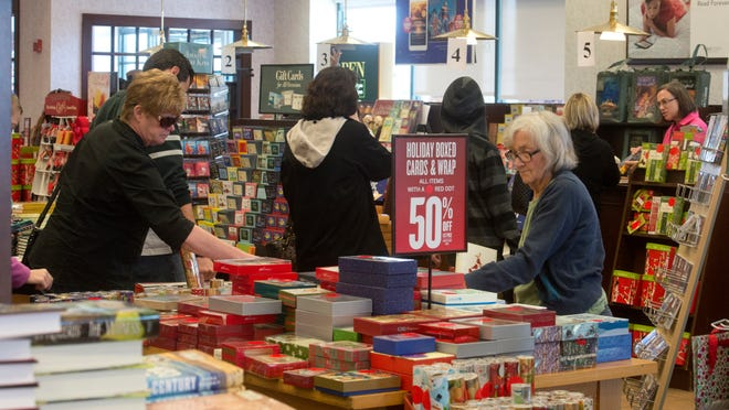Bargain hunters shop at area stores in search of after Christmas deals Friday morning.