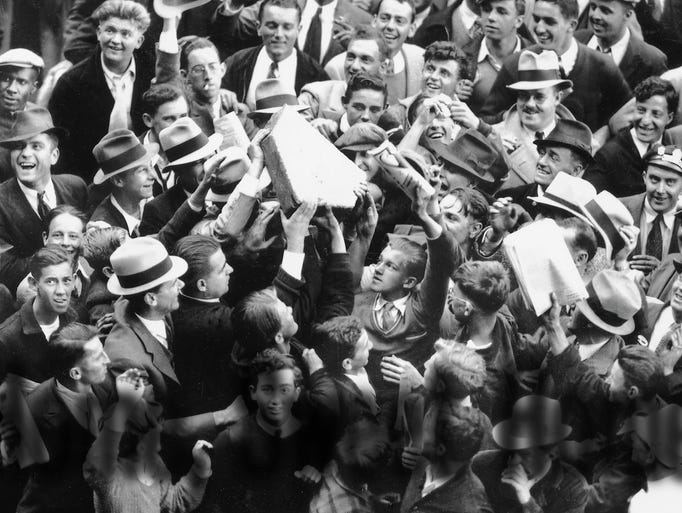 On Oct. 9, 1934, Tiger fans storm the infield and hoist