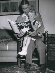 Theodor Seuss Geisel reads to 4-year-old Lucinda Bell