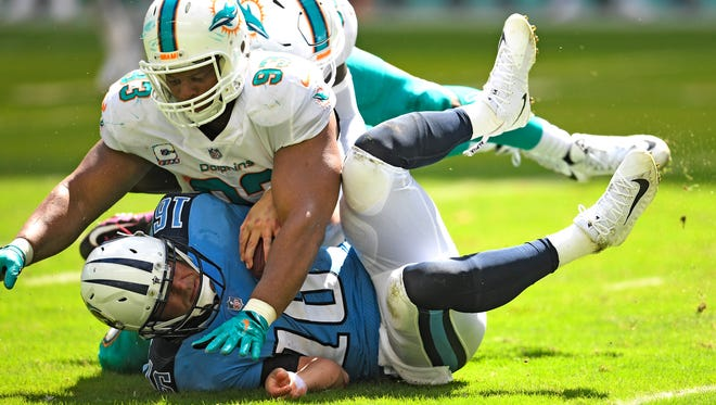 Titans quarterback Matt Cassel (16) is sacked by Dolphins defensive tackle Ndamukong Suh (93) during the second quarter Sunday, Oct. 8, 2017, at Hard Rock Stadium in Miami Gardens, Fla.
