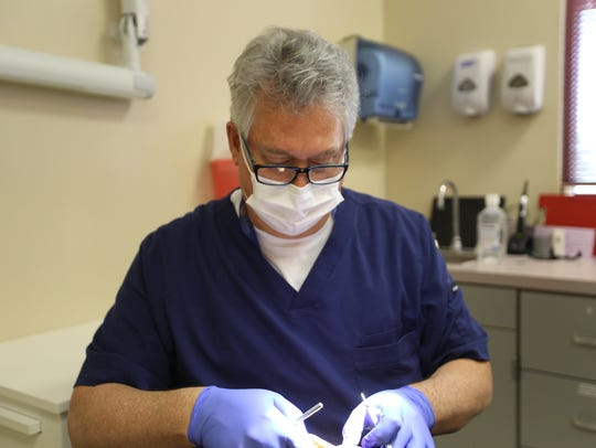 Dr. John Landgren is a pediatric dentist in the Gila