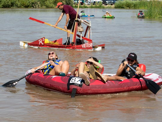 Three girls having a good time during the Raft the