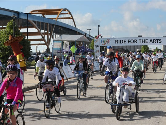 Bicyclists start the United Performing Arts Fund Ride for the Arts' 12-mile route on Sunday outside the Summerfest grounds on the Milwaukee lakefront in 2018. UPAF raises funds for local performing arts groups and the rides are part of its fundraising efforts.
