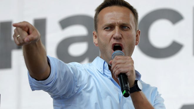 FILE - In this Saturday, July 20, 2019 file photo Russian opposition activist Alexei Navalny gestures while speaking to a crowd during a political protest in Moscow, Russia. Russian opposition politician Alexei Navalny was placed on a ventilator in a hospital intensive care unit in Siberia after falling ill from suspected poisoning during a flight, his spokeswoman said Thursday Aug. 20, 2020.