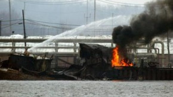 A sunken gasoline barge in the Arthur Kill in 2003 following an explosion while the vessel offloaded fuel at the Port Mobil terminal in Staten Island, New York