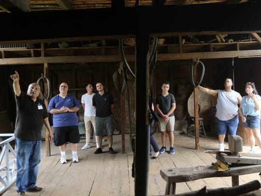 Joe Restivo (far left), of Bergenfield, gives a tour of the Westervelt-Thomas Barn at Historic New Bridge Landing in River Edge.  Sunday, July 22, 2018
