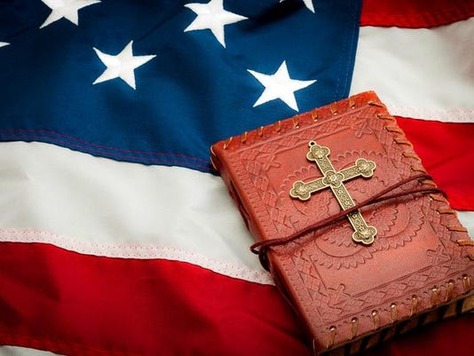 American flag, red vintage bible with a gold cross