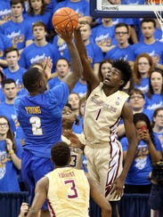 Pitt forward Michael Young shoots against Florida State