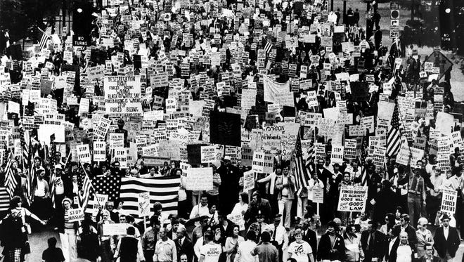 Thousands of demonstrators marched peacefully behind Sue Connor, center front, in Louisville yesterday, protesting court-ordered busing.