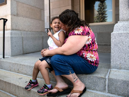 Ariel Myles, 4, left, motions to her grandmother, Shannon