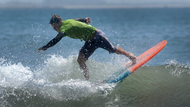Ryan Pierson competes during the 2015 C Street Classic surfing contest and Aloha Beach Festival in Ventura.