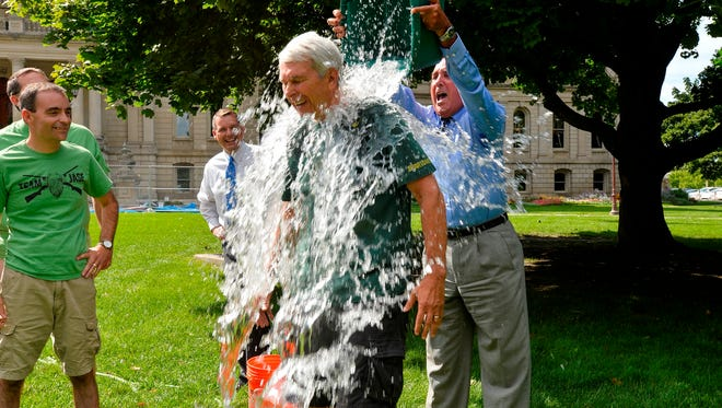 Norm Saari, the state House Republicans chief of staff, is soaked on the Capitol lawn while he and other GOP staffers participate in the Ice Bucket Challenge on Wednesday.