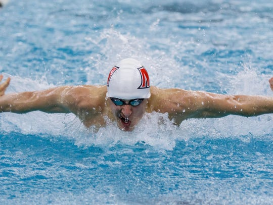 Muskego swimmer Ben Gabbey, shown in a meet last season, says he has benefited from a change of club teams.