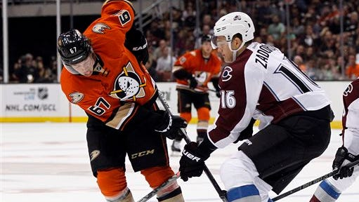Anaheim Ducks center Rickard Rakell (67), of Sweden battles Colorado Avalanche defenseman Nikita Zadorov (16), of Russia for the puck during the second period of an NHL hockey game in Anaheim, Calif., Friday, Oct. 16, 2015. (AP Photo/Alex Gallardo)
