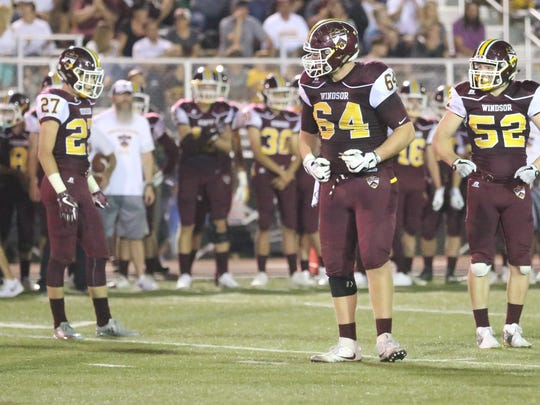 Windsor High School's Zach Watts, center, motivates