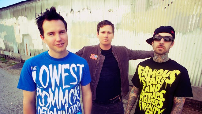 Blink-182 in their first incarnation: Mark Hoppus, Tom Delonge and Travis Barker.