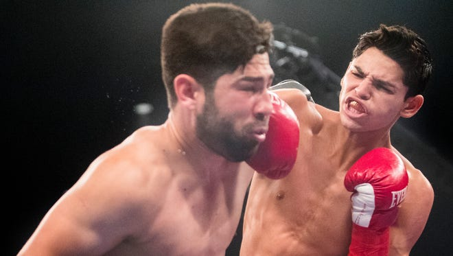 Ryan Garcia, of Victorville, California lands a straight right on Fernando Vargas of Tijuana, Mexico during their bout at Fantasy Springs Casino on March 22, 2018.