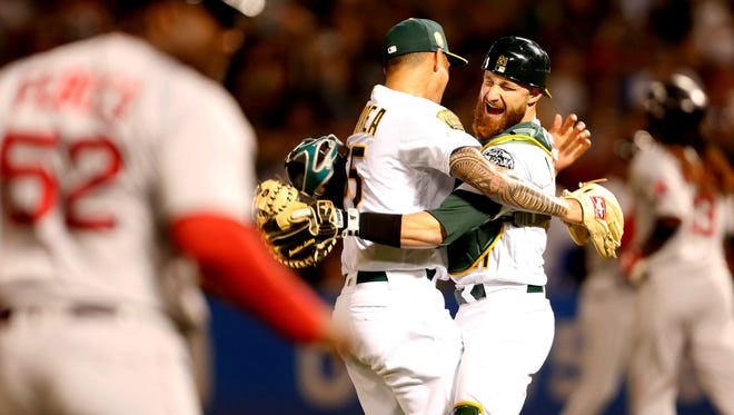 Oakland Athletics pitcher Sean Manaea (55) celebrates with teammate Jonathan Lucroy (21) after pitching a no-hitter against the Boston Red Sox at Oakland Coliseum.