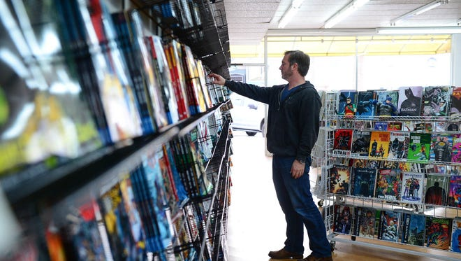 Joel Antonioli, Ocean View, looks at the comic selection at Comics and Gaming located in Bethany Beach on Wednesday, Nov. 15, 2017.